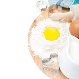 Baking ingredients - flour, eggs, milk and baking forms Stock Photos