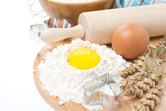 Baking ingredients - flour, eggs, rolling pin and baking forms Royalty Free Stock Photo