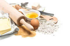 Baking ingredients flour, eggs. Wooden kitchen utensils. Food ba Stock Photography