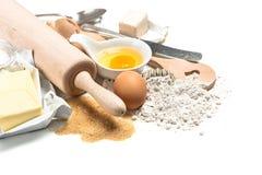 Baking ingredients flour, eggs. Wooden kitchen utensils. Food ba Stock Photography