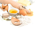 Baking ingredients flour, eggs, yeast, sugar, butter. Food backg Stock Photography