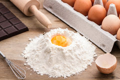 Baking ingredients. Flour with rollin pin on wooden background, making a cake, making homemade dough and pastry, rolling dough on pastry board Stock Image