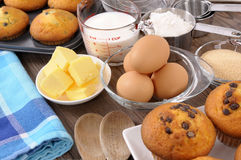 Baking cake ingredients with fresh muffins Royalty Free Stock Photos