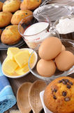 Baking cake ingredients with fresh muffins Royalty Free Stock Images