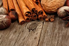 Baking ingredients and holiday spices close up on rustic wood Royalty Free Stock Photography
