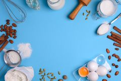 Baking ingredients for homemade pastry on blue background. Bake sweet cake dessert concept. Top view. Flat lay. Copy space stock photo