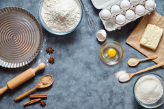 Baking ingredients for homemade pastry on dark background. Bake sweet cake dessert concept. Top view, flat lay. Style stock images
