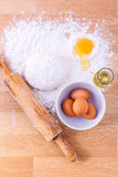 Baking ingredients including fresh eggs, flour and a rolling pin Stock Images