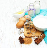 Baking ingredients. On a old wooden background Stock Photos