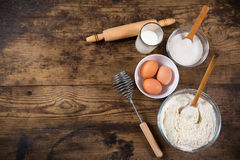 Free Baking Ingredients On Brown Wooden Table Stock Image - 52812951