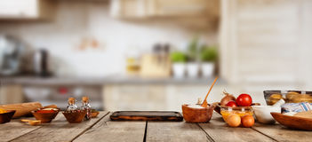 Baking ingredients placed on wooden table stock photo