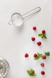 Baking Ingredients. Raspberries with icing sugar. Copy space with raspberries, preparing cake, top view royalty free stock image