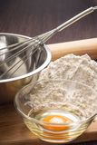 Baking ingredients with rolling-pin on board Royalty Free Stock Photos