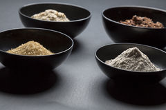 Baking ingredients. Some black bowls with baking ingredients Stock Photo