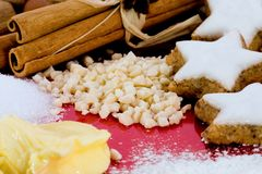 Baking ingredients and star-shaped cinnamon biscui Royalty Free Stock Photo