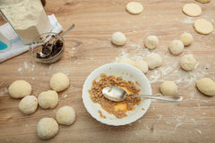 Baking ingredients on a wood table Royalty Free Stock Photography