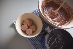 Baking in the kitchen, home related. Things used for baking in the kitchen, home related. Eggs, butter, flour and chocolate cake mixture Stock Photography