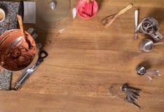 Baking kitchen utensils, kitchenware on wooden table top view. Various baking kitchen utensils on wooden table top view, copy space Stock Photo