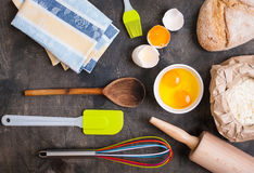 Baking kitchen utensils on vintage planked wood table from above Royalty Free Stock Photography