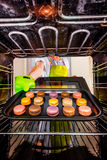 Baking macarons in the oven. Stock Images
