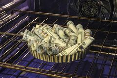 Baking money pie in oven stock photography