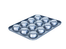 Baking muffins tray 12th hole. non-stick coating. isolated on wh Royalty Free Stock Photography