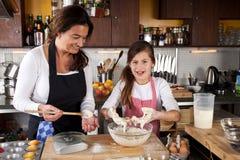 Baking with mum Royalty Free Stock Image