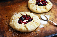 Baking open pie or galette with apples and berries Royalty Free Stock Photography