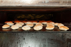 Baking oven with pita bread Stock Photography