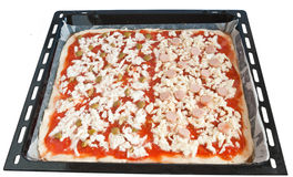 Baking pan with pizza Royalty Free Stock Photo