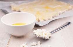 Baking pie with crumbled cheese and eggs Stock Image