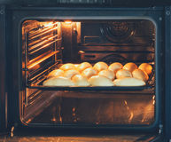 Baking pies with fillings prepared in the electric oven Stock Images