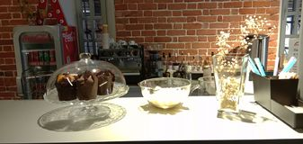 Baking, pies, muffins, strudel in a glass vase at the counter of the cafe. royalty free stock images
