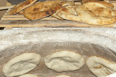 Baking pita bread in a stone oven Royalty Free Stock Photos