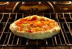 Baking pizza Stock Image
