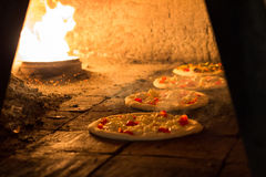 Baking pizza oven Royalty Free Stock Images