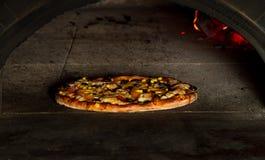 Baking pizza Royalty Free Stock Photos