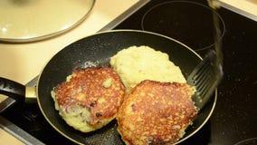 Baking potato pancakes. hand turn upside pancakes and close pan stock video