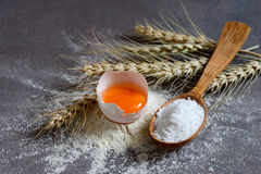 Baking powder in a wooden spoon Stock Image