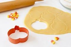 Baking Pumpkin Shaped Cookies Royalty Free Stock Photography