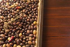 Baking raw, colorful, organic olives Stock Photos