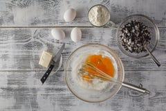 Baking in rustic kitchen recipe ingredients (eggs, flour, milk, Royalty Free Stock Image