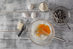 Baking in rustic kitchen recipe ingredients (eggs, flour, milk, Royalty Free Stock Image