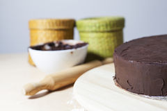 Baking's Time. A chocolate bowl with a Kneader and a half cake Royalty Free Stock Photography