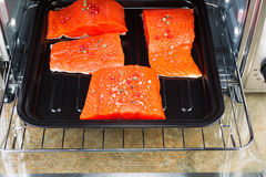 Baking Salmon in Oven Royalty Free Stock Image