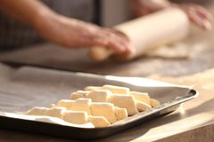 Baking sheet with raw croissants and blurred woman Royalty Free Stock Photography