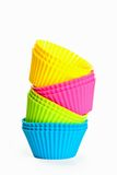 Baking silicone cups for cupcakes or muffins. On white background Royalty Free Stock Images