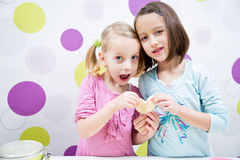 Baking sisters. Sisters baking, heart cake, happy child royalty free stock photography
