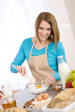 Baking - Smiling woman with healthy ingredients Royalty Free Stock Image