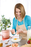 Baking - Smiling woman with healthy ingredients Stock Photos